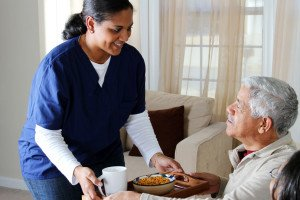 Caregiver serving meals in home Dallas Fort Worth Metroplex